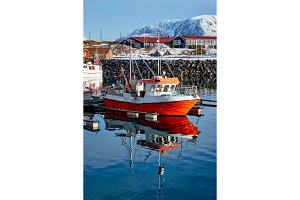 Fishing boats and yachts on pier in