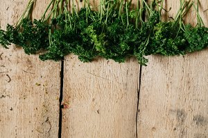 wooden background with fresh herbs