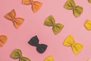 Pasta farfalle lies diagonally