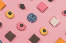 Multicolored candies lies diagonally by  in Food & Drink