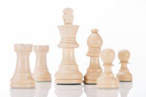 white wooden chess figures on white
