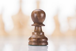 wooden chess pawn on chessboard, bus