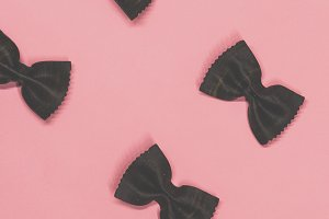 Black pasta farfalle lies diagonally