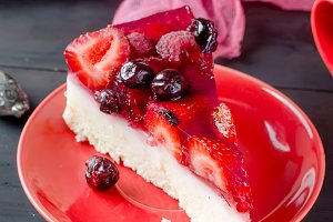 cake or cheesecake with berries and
