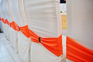 Decorated chairs with orange ribbon