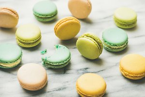 Colorful French macaroons over grey