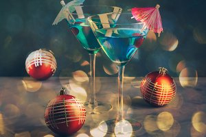 Blue cocktail in martini glass for