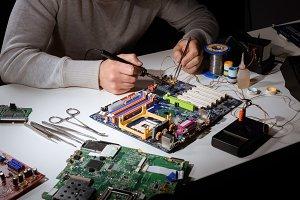 Engineer working with soldering equi