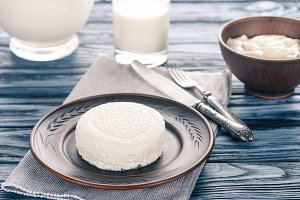 fresh healthy cottage cheese on plat