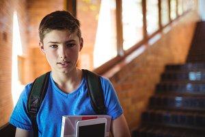 Portrait of schoolboy holding