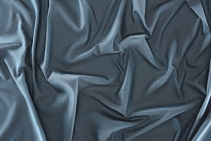 close up view of crumpled blue silk