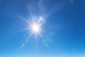sky background with sun beams on
