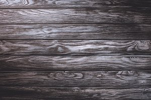 Wooden planks painted in grey backgr