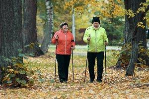Mature women walking in an autumn