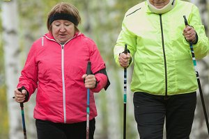 Two jacket dressed elderly women are