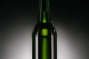close up view of bottle of beer on d