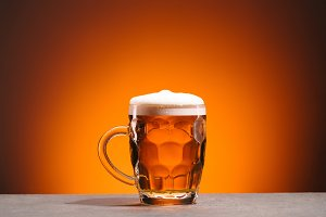 close up view of mug of cold beer on