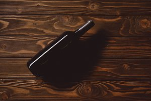 top view of bottle of red wine on wo