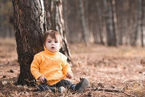 Baby boy in forest