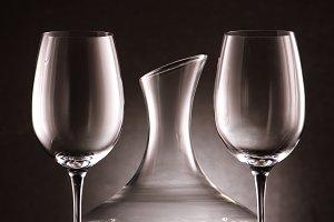 empty decanter between two wineglass