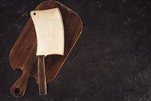 top view of butcher axe on wooden cu