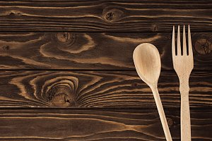 top view of fork and spoon on wooden