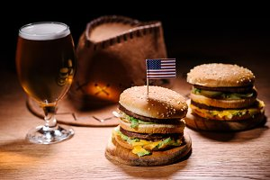 tasty burgers on wooden table with a