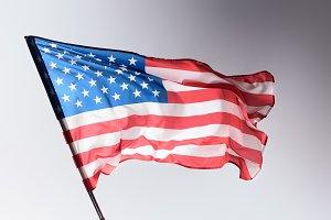 waving united states flag on grey, I