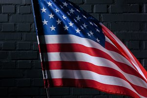 united states flag in front of black