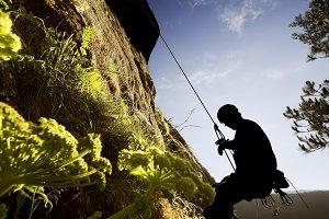 man rock climber in  climbs
