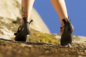 feets at  woman rock climber