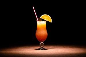 tasty alcohol cocktail with orange j