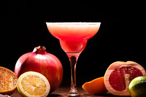 red alcohol drink with ripe fruits o