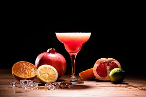red alcohol drink with fruits and ic