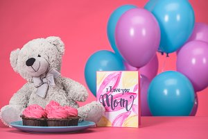 teddy bear with cupcakes and postcar