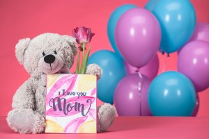 teddy bear with pink tulip and postc