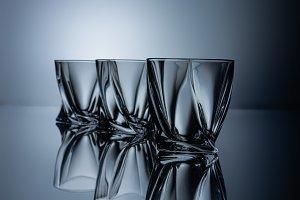 row of empty cognac glasses on grey
