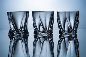 row of three empty whiskey glasses o