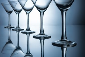 row of elegant empty martini glasses