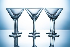 row of transparent martini glasses o