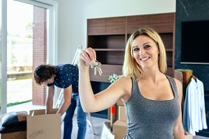 Woman showing keys while her husband