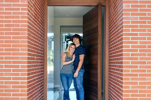 Couple at the entrance of their hous