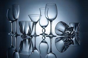 silhouettes of martini, cognac, cham