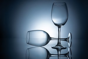 silhouettes of empty wineglasses wit
