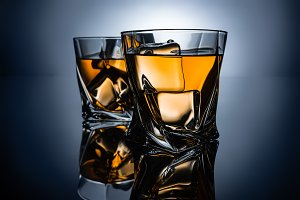 two glasses of whiskey with ice cube
