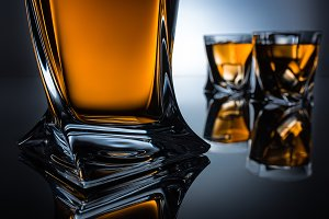 selective focus of cognac bottle and