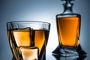 selective focus of whiskey glass wit