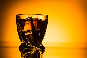 silhouette of glass with cognac and