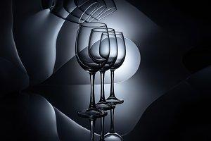 row on empty wine glasses, dark stud