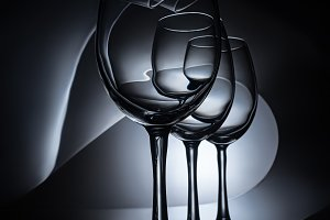 row on elegant wine glasses, dark st